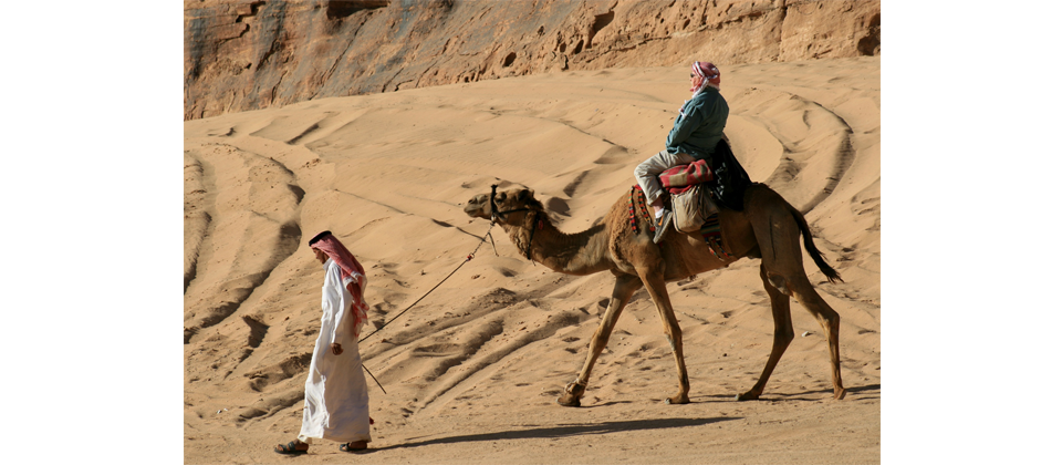 pp-25_-_riding_a_camel_in_wadi_rum_led_by_a_bedouin.png